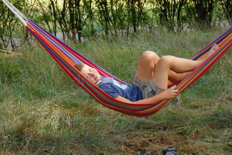 Boy in a hammock stock image