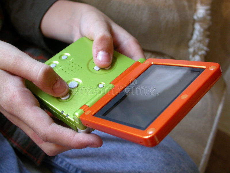 Boy and handheld video game close up royalty free stock photo