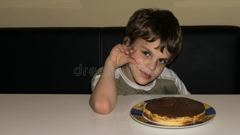 Boy and handmade cake, person royalty free stock photo