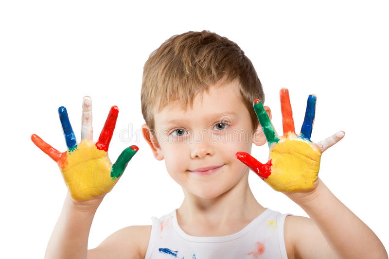 Boy with hands in paint on white royalty free stock photography