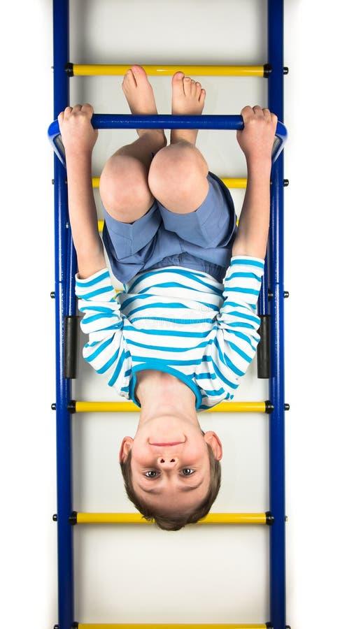 Boy hanging upside down royalty free stock photos