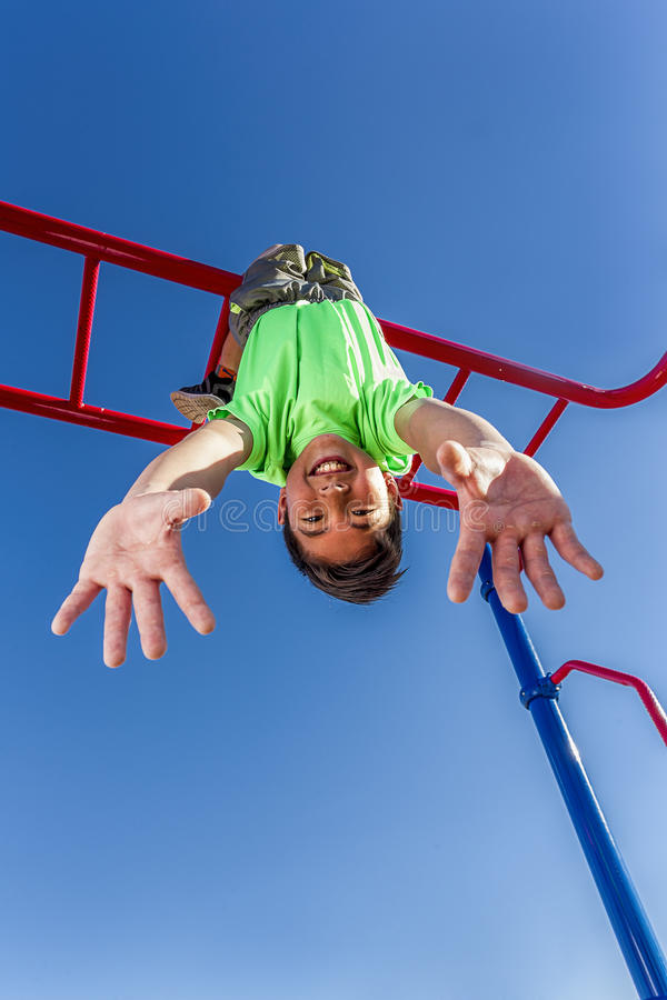 Free Boy Hangs Upside Down While Playing. Royalty Free Stock Image - 98176696