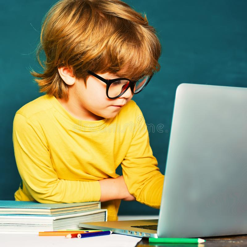 Boy with happy face expression near desk with school supplies. Private school. Teachers day. Ready for school. School. Concept royalty free stock images