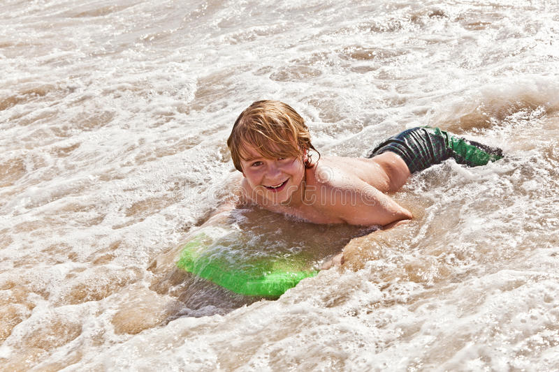 Download Boy Has Fun With The Surfboard Stock Photo - Image: 18077698