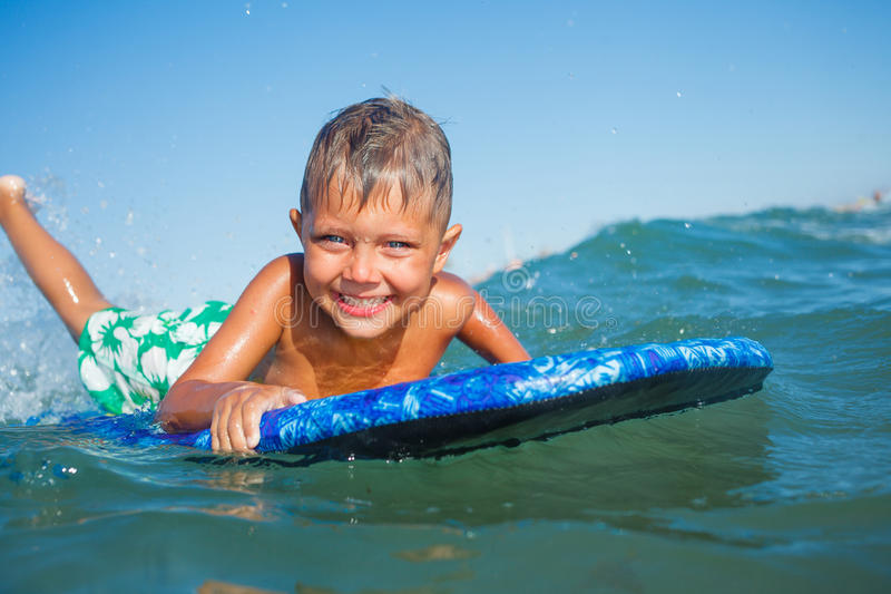 Download Boy Has Fun With The Surfboard Stock Photo - Image: 36378888