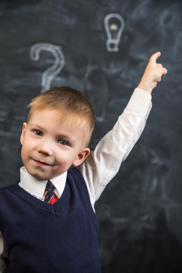 The boy has an idea drawn on the Board light bulb royalty free stock image