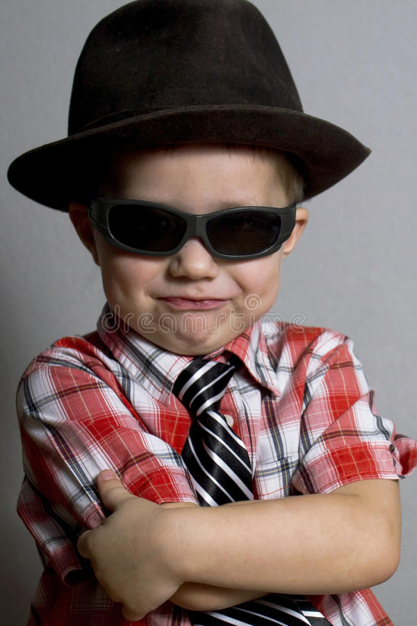 The boy in a hat and black glasses royalty free stock images