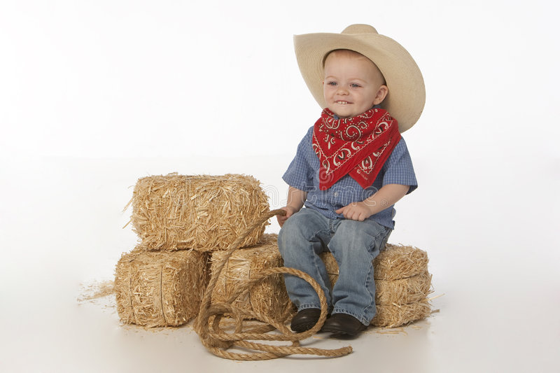 Boy with hat and Saddle stock photography