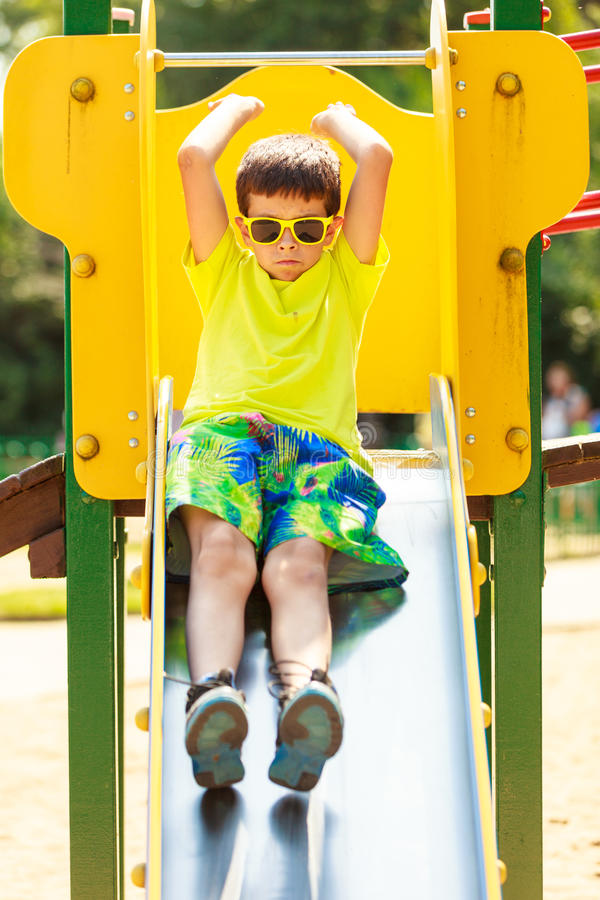 Boy have fun on slide. royalty free stock image