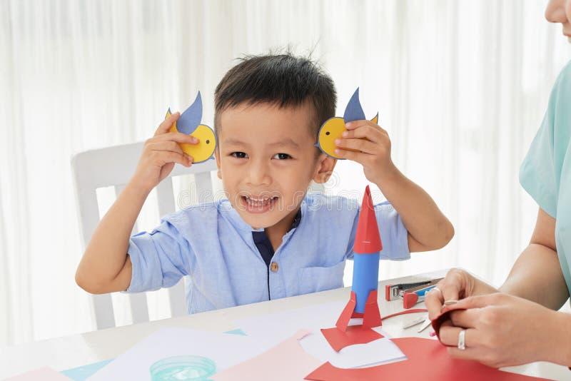 Boy having fun with paper birds royalty free stock photos
