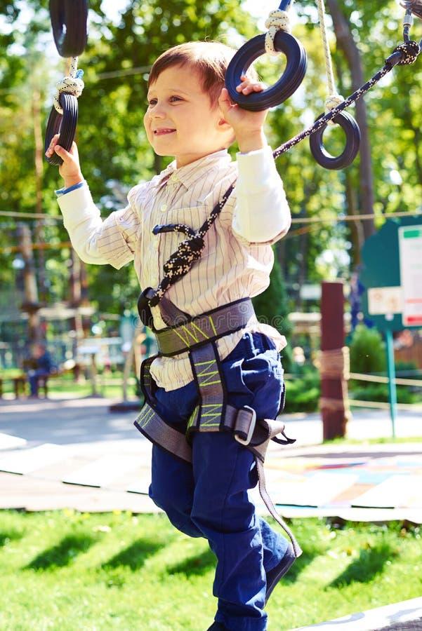 Boy having fun in rope park royalty free stock photo