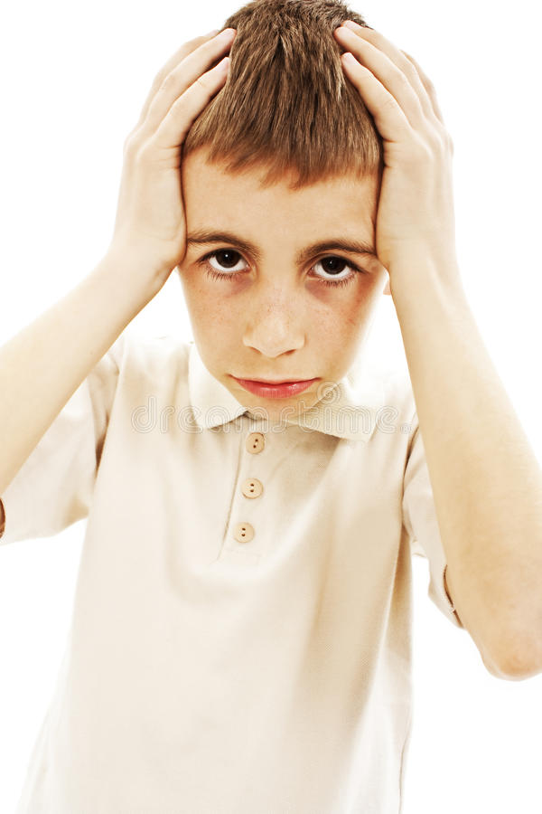 Boy with head ache. Or being confused holding hand to forehead isolated on white background royalty free stock photography