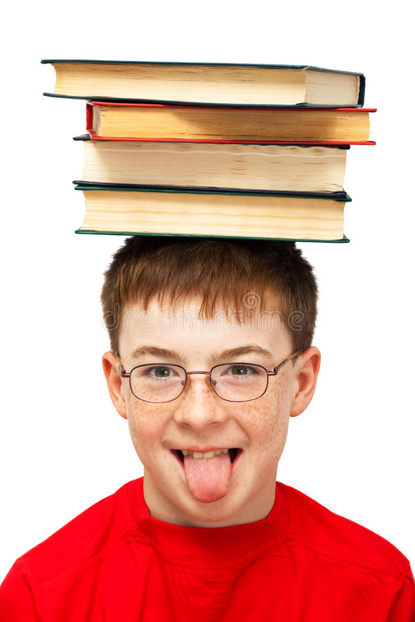 Boy on head with books stock photo