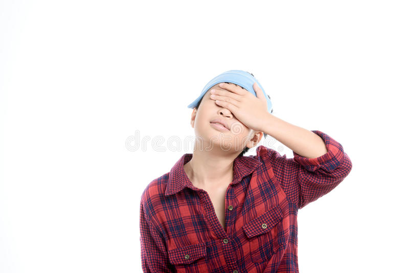 Boy headache. Young Thai boy headach by an illness and use ice cube to decrease temperature stock photo