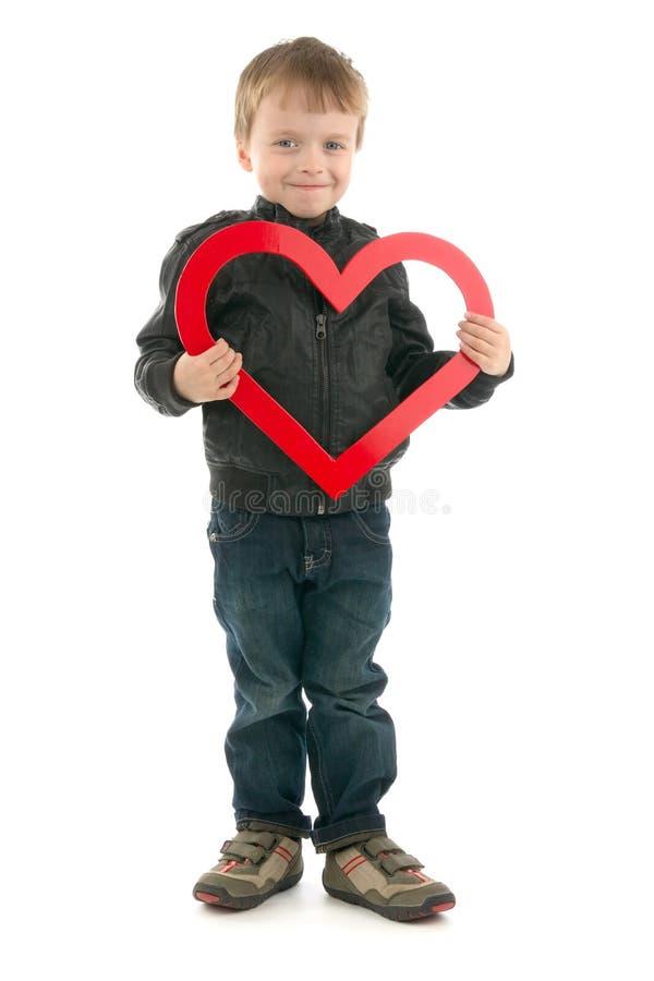 Boy and heart stock photos