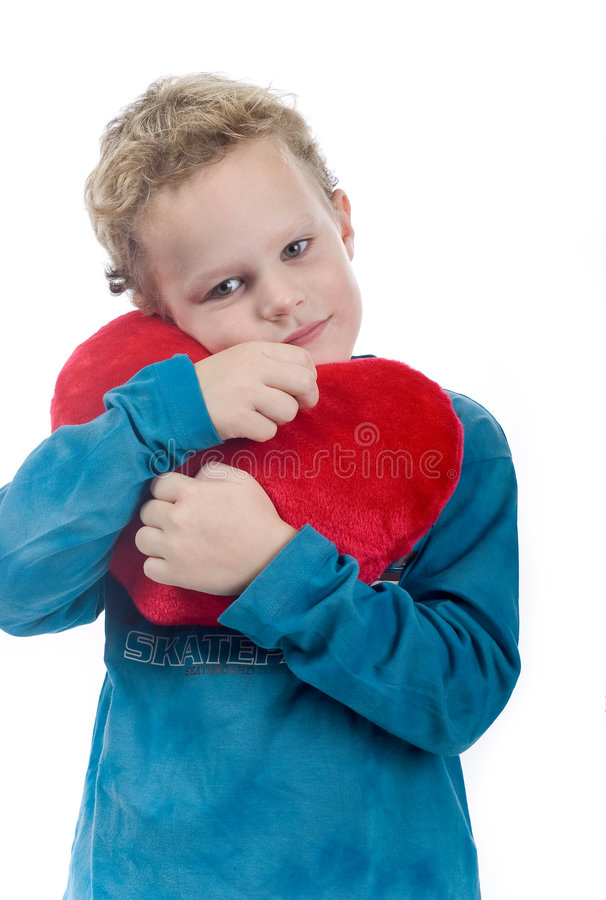 Boy with heart shaped cushion royalty free stock photography
