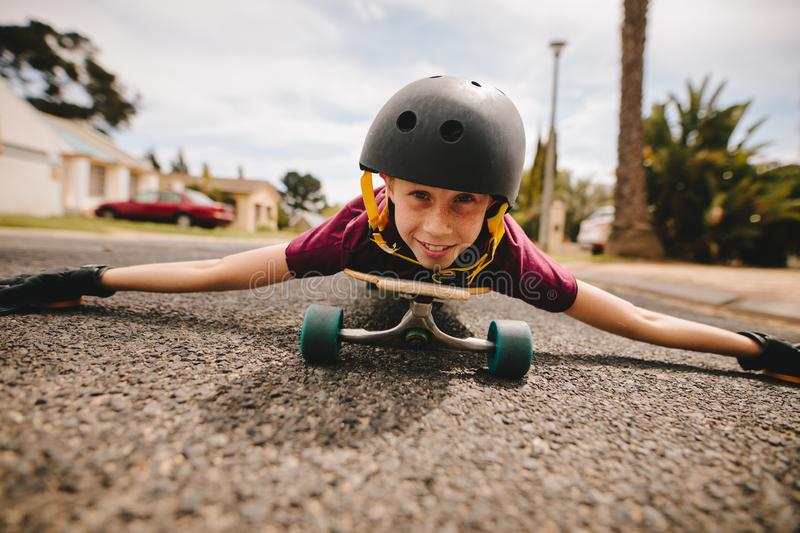 Boy playing on his skateboard royalty free stock images