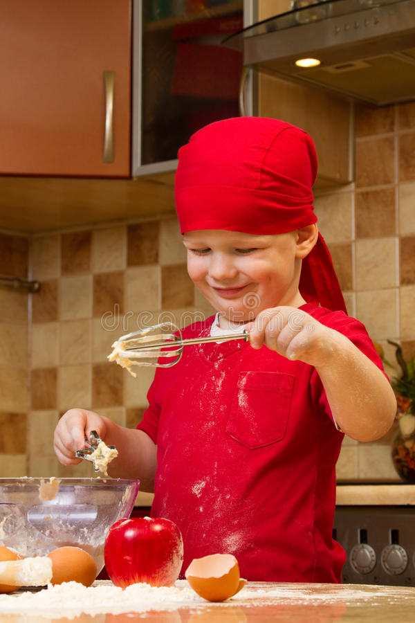 Download Boy Helping At Kitchen With Baking Pie Stock Image - Image: 17145245