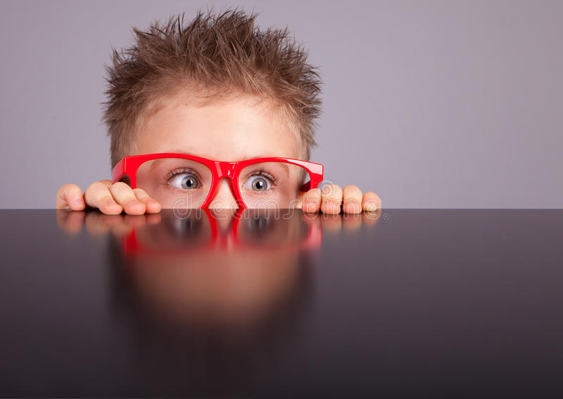 Download Boy hiding behind a table stock photo. Image of hidden - 29046784