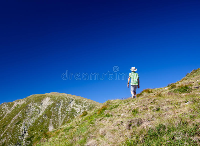 Download Boy Hiking Into The Mountains Stock Image - Image: 26079969