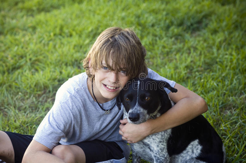 Boy and his dog royalty free stock photo
