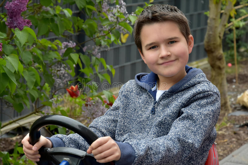 Boy and his first car royalty free stock photo