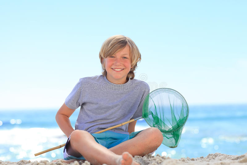 Boy With His Fishing Net Royalty Free Stock Photography