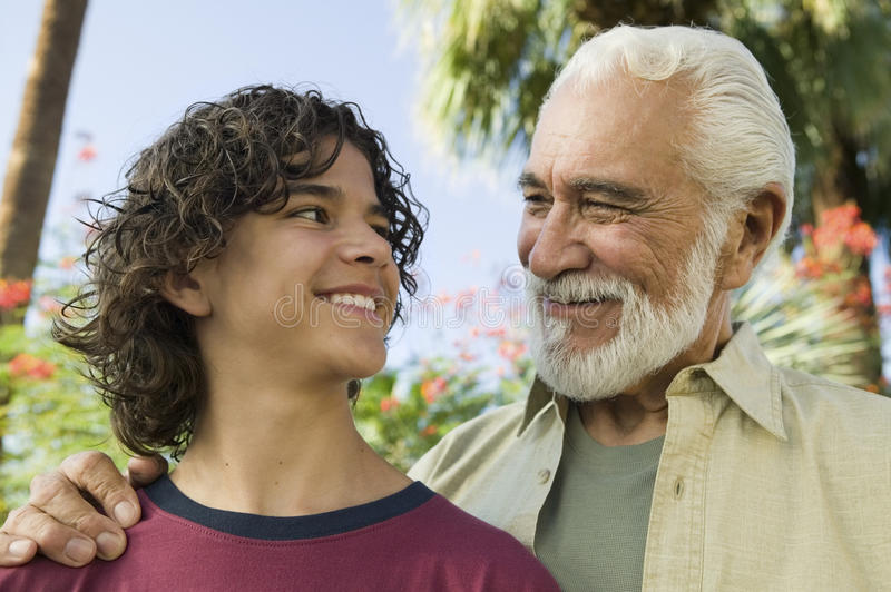 Boy With His Grandfather Outdoors stock photos
