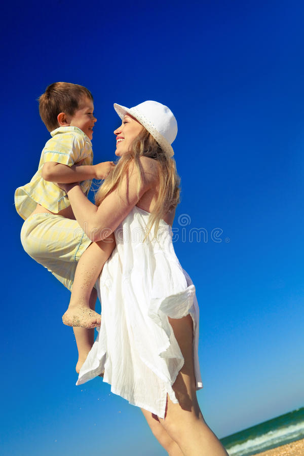 Boy is on his mother's hands stock images