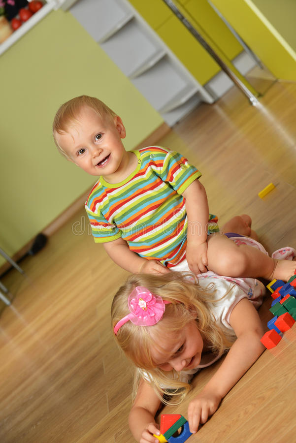 Download Boy with his sister stock photo. Image of color, playful - 26889802