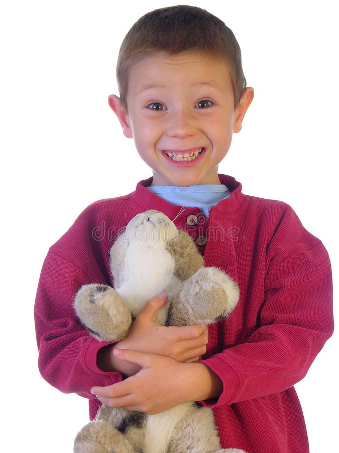 Boy and his stuffed pet. Small boy holding his stuffed animal royalty free stock photography
