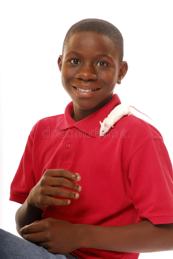 Boy with His Tiny Pet. Smiling African American adolescent boy with a white mouse on his shoulder stock image