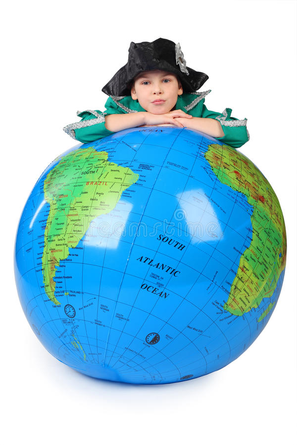 Boy in historical dress leans on inflatable globe