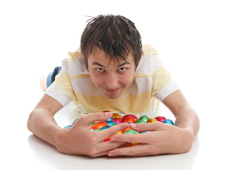 Boy Hoarding Easter Eggs Royalty Free Stock Photography