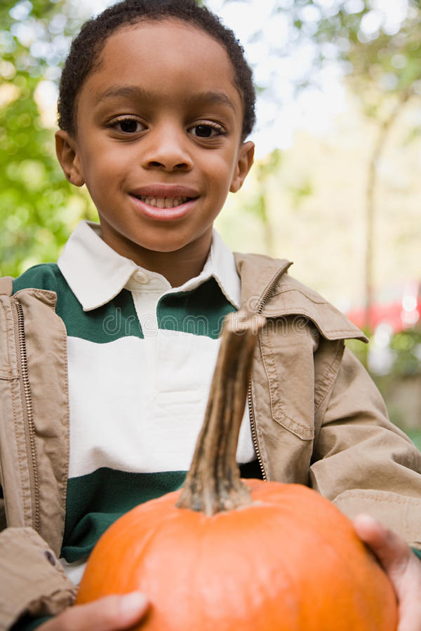 Free Boy Holding A Pumpkin Royalty Free Stock Photography - 36095297