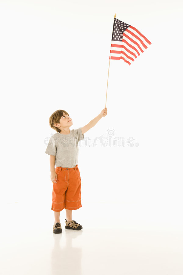 Boy holding American flag. Boy holding American flag against white background royalty free stock photography