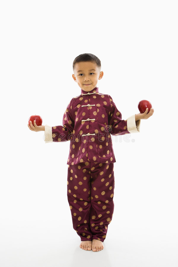 Boy holding apples. stock images