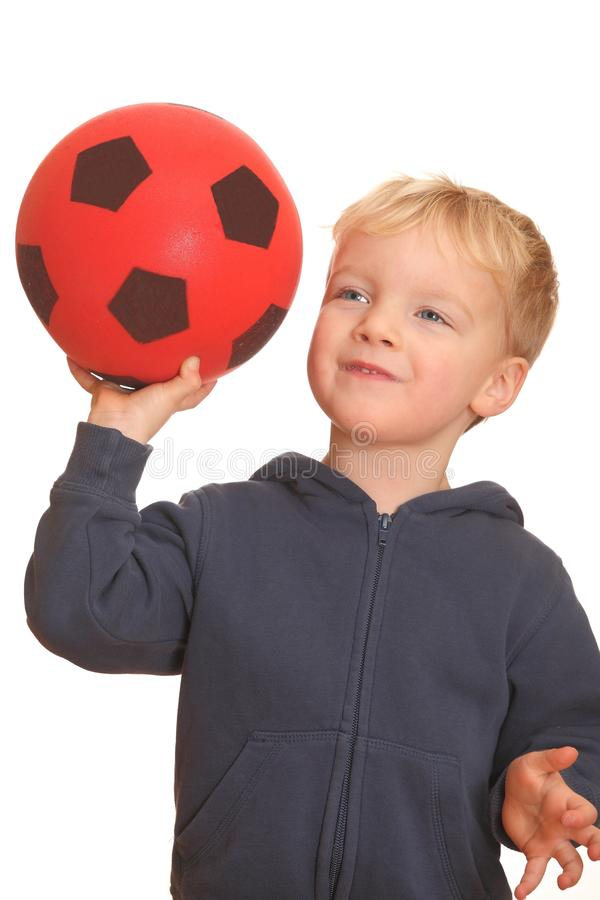 Download Boy holding a ball stock image. Image of football, cute - 17983875