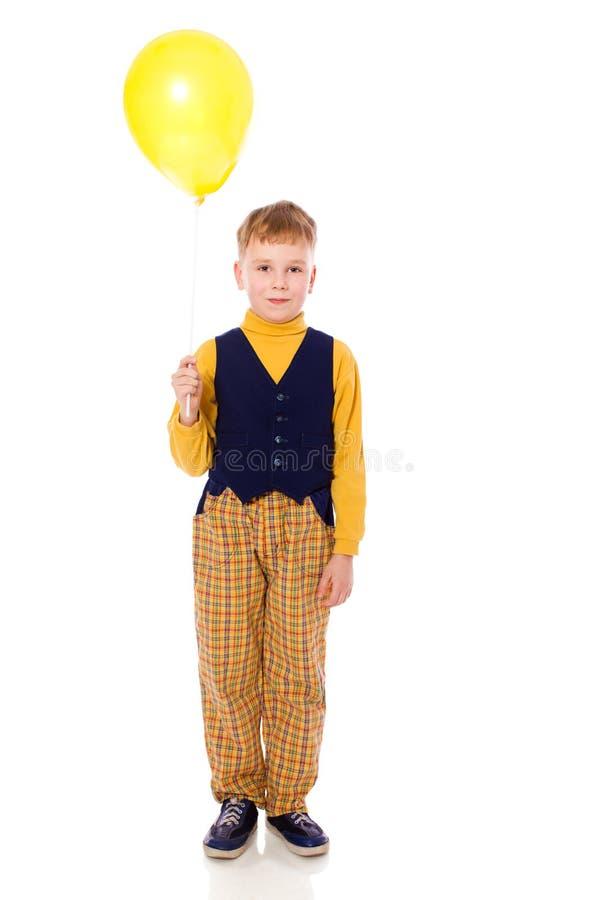Boy Holding Balloon. Little Boy Holding Balloon standing isolated on white stock image