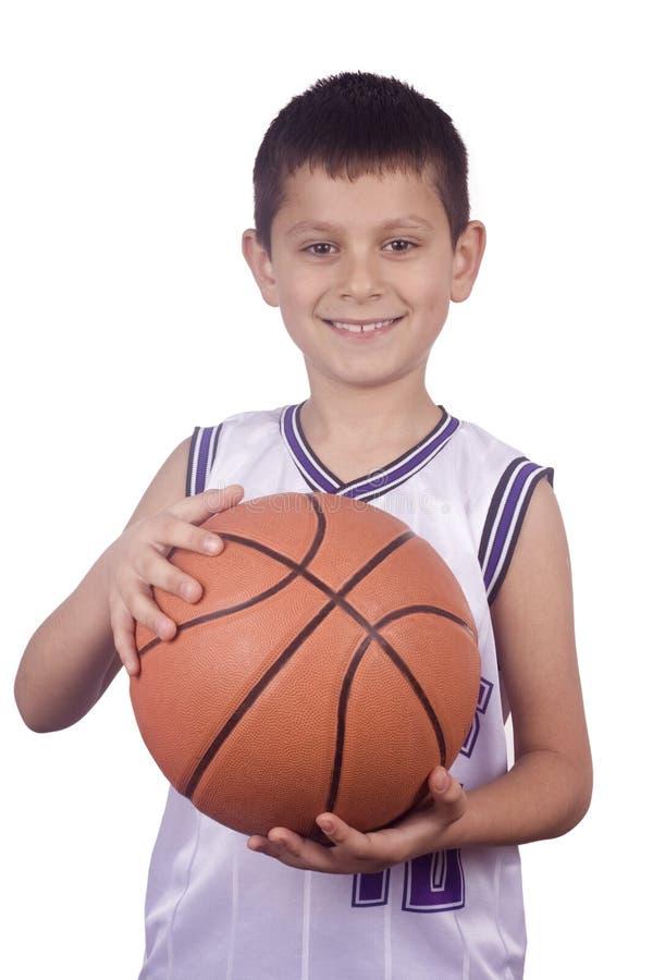 Boy holding basketball stock image