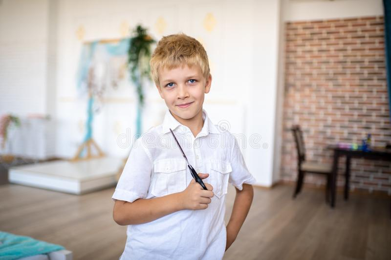 Boy holding big hair clippers stock photos