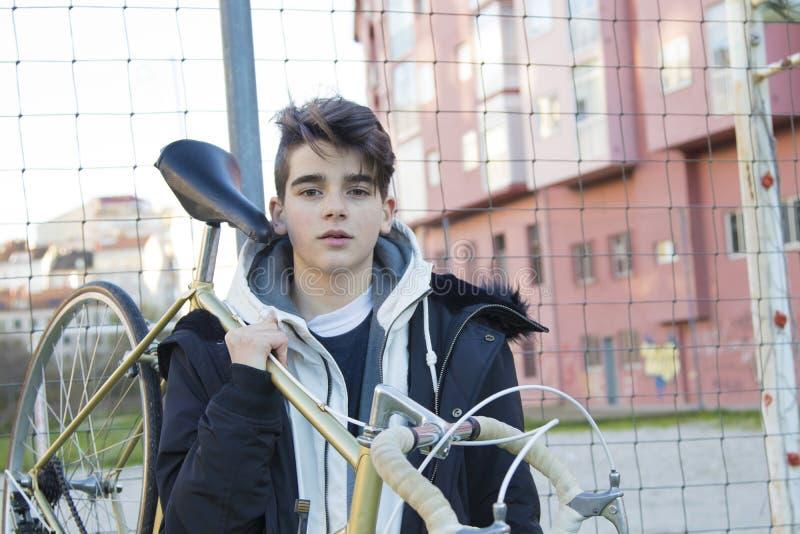 Boy holding bike stock image