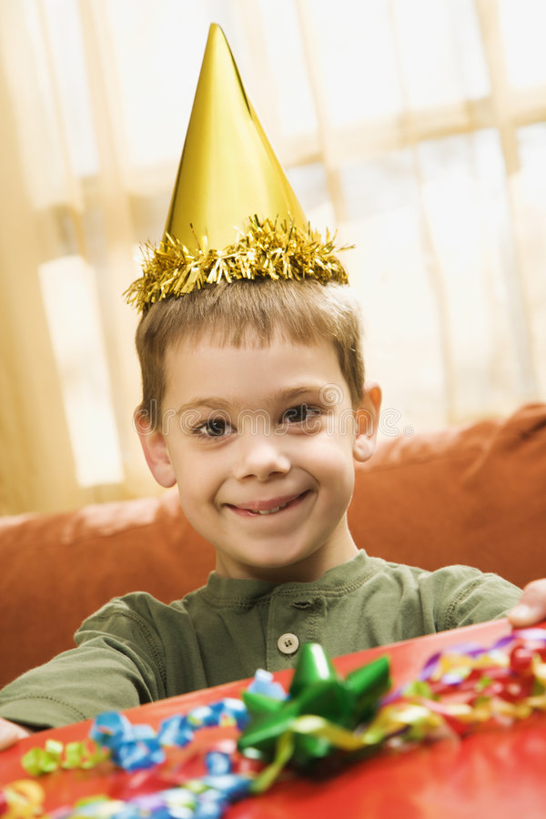 Boy holding birthday gift. stock images