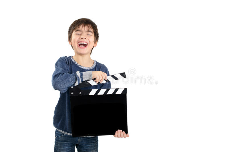 Boy holding black clapperboard. Which allows own free caption on it stock images