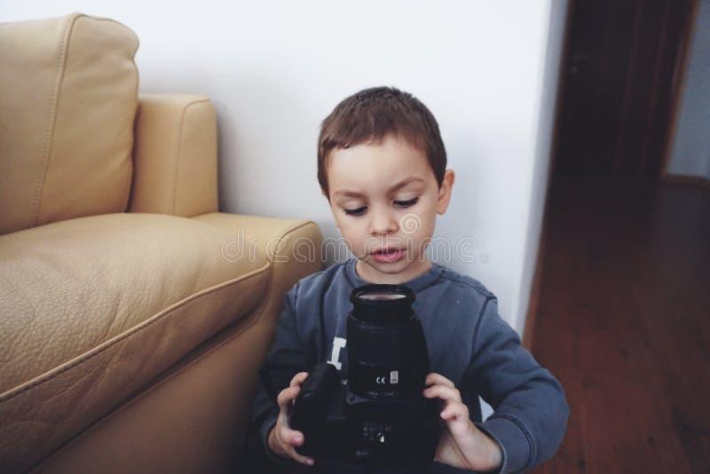 Boy Holding Black Dslr Camera stock image