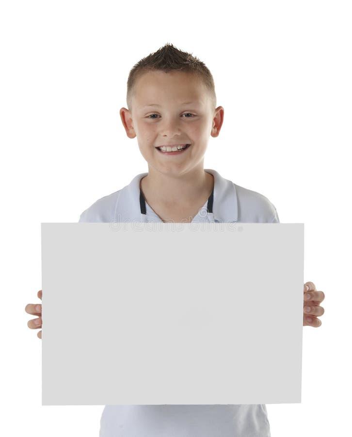 Boy holding blank board royalty free stock photos