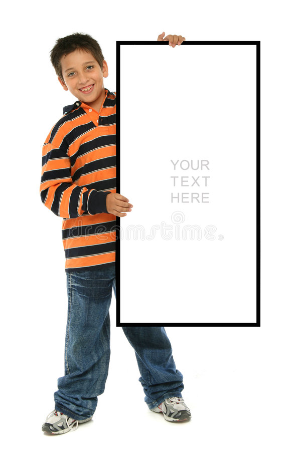 Boy holding a blank sign. Child holding an empty sign over a white background royalty free stock photography