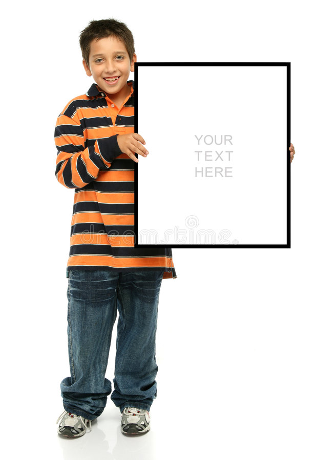Boy holding a blank sign. Child holding an empty sign over a white background royalty free stock image