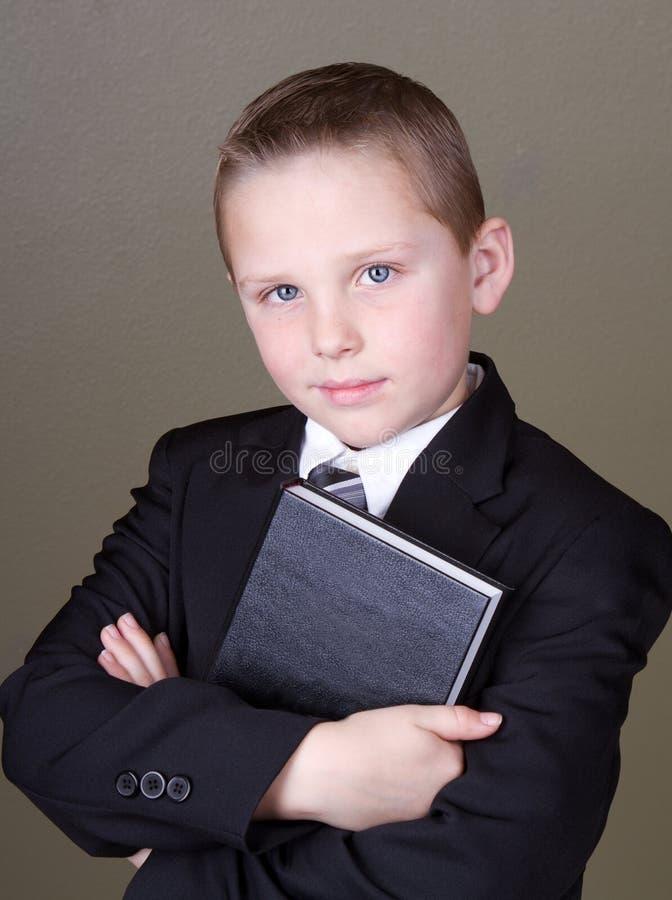 Boy holding book royalty free stock photo