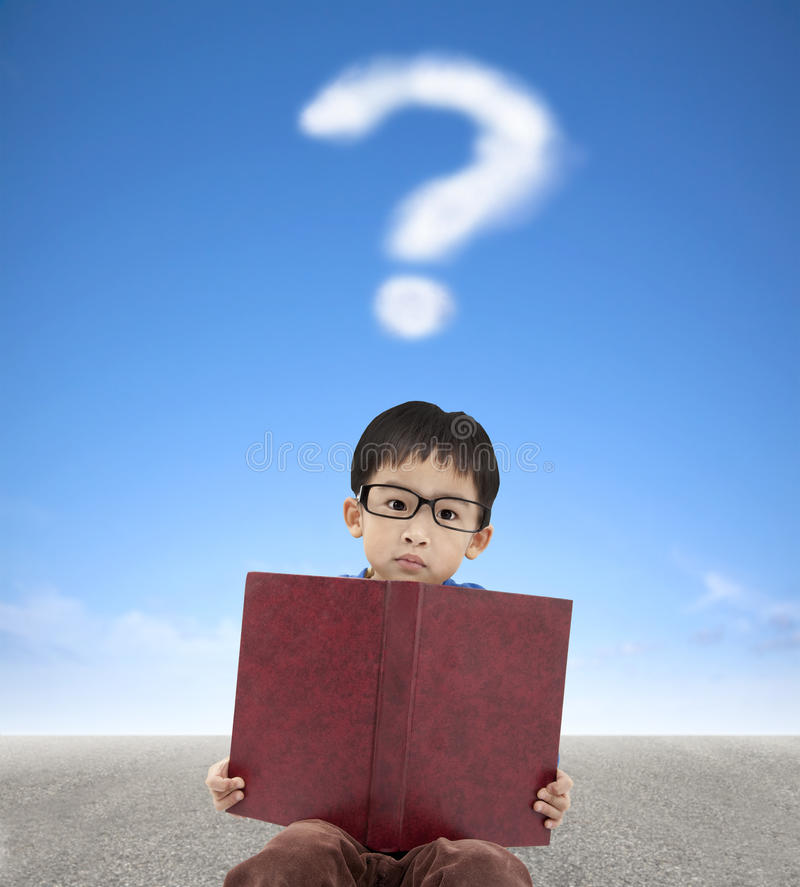 boy holding book and question mark stock photos